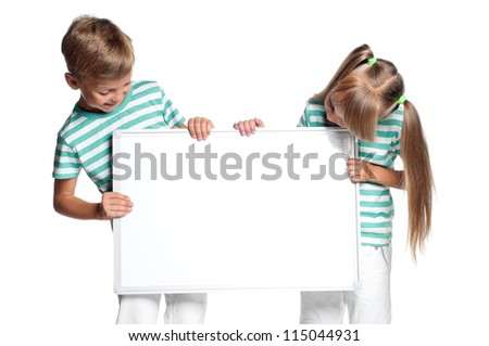 Happy boy and little girl with white blank isolated on white background - stock photo