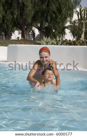 happy boy and mom in the swimming pool