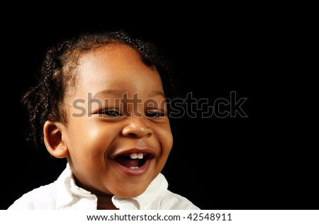 happy boy baby on black background - stock photo