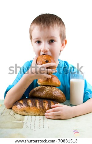 Happy boy eating bread on a white background