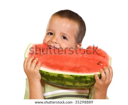 Happy boy eating large watermelon slice - isolated