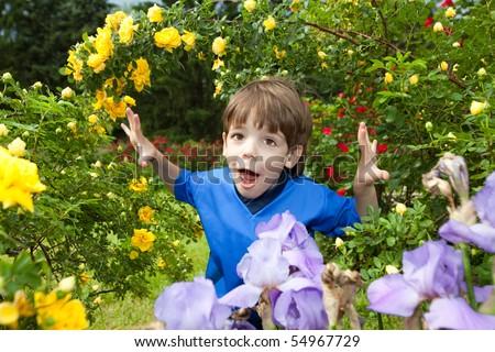 Happy boy enjoy on Flowers - stock photo