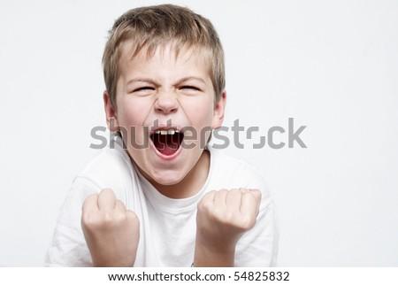 Happy boy football fan on light background - stock photo