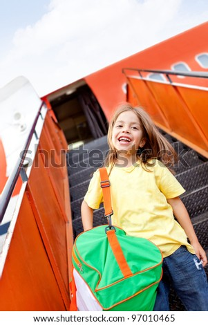 Happy boy going on holidays by airplane - stock photo