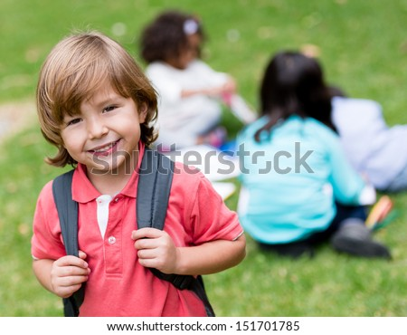 Happy boy going to school and smiling outdoors  - stock photo