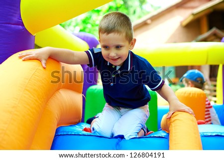 happy boy having fun on playground - stock photo