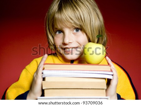 happy boy holding a book - stock photo