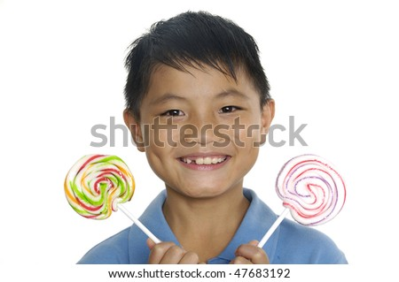 Happy boy holding candy - stock photo