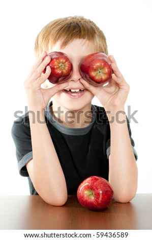 Happy Boy Holding Delicious Red Apples - stock photo