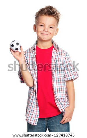 Happy boy holding small soccer ball in hand isolated on white background - stock photo