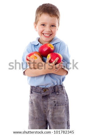 Happy boy holds a three red apples, isolated on white - stock photo