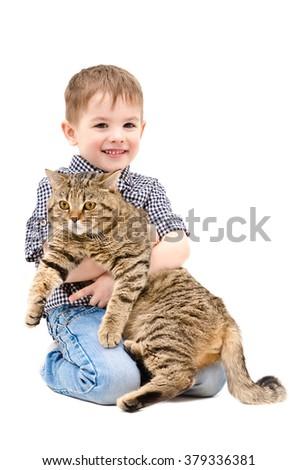 Happy boy hugging a cat Scottish Straight sitting isolated on white background - stock photo