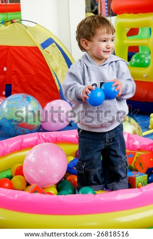 happy boy in playing room - stock photo