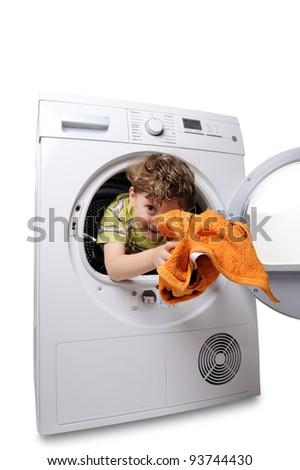 happy boy in the washing machine - stock photo