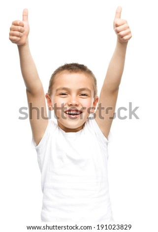 Happy boy is showing thumb up gesture using both hands, isolated over white - stock photo