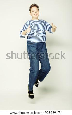 happy boy jumping - stock photo