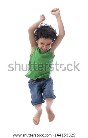 Happy Boy Jumping with Joy over White Background