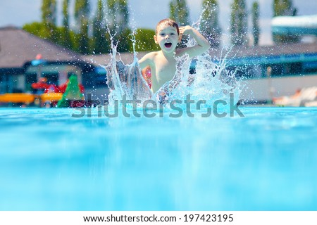 happy boy kid jumping in the pool - stock photo