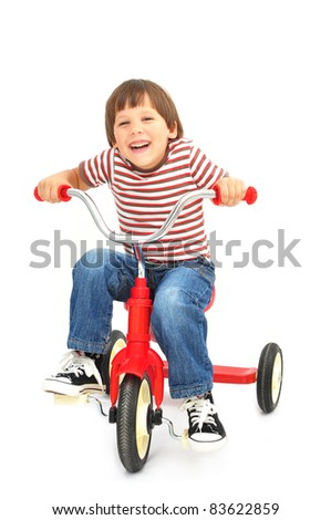 Happy boy on bicycle - stock photo
