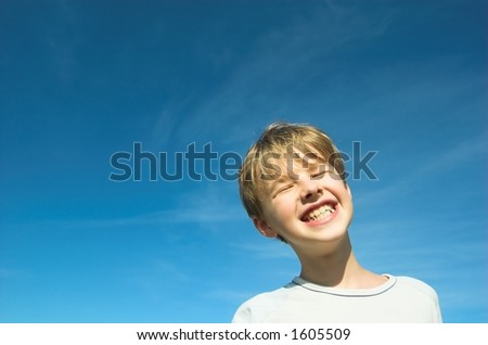 Happy boy on sky background - stock photo