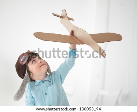 happy boy play in airplane  indoors