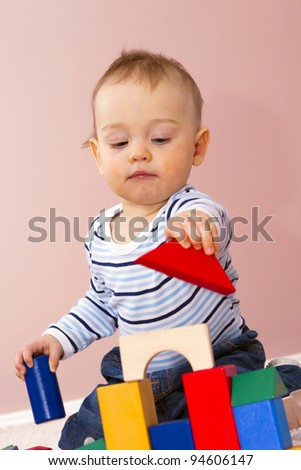 Happy boy playing frame construction. - stock photo