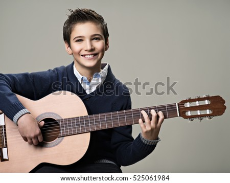 Happy Boy Playing On Acoustic Guitar Teenager With Classic Wooden