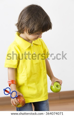 Happy Boy Playing with Apple, Eating Healthy Food - stock photo