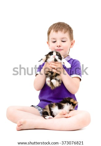 Happy boy playing with kittens isolated on white background - stock photo