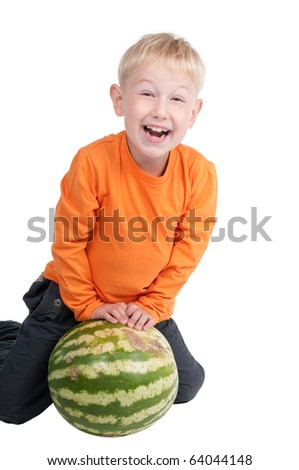 Happy boy playing with watermelon - stock photo