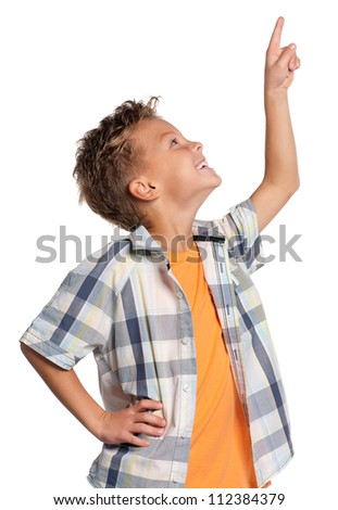 Happy boy pointing up isolated on white background - stock photo