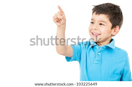Happy boy pointing with his finger - isolated over a white background - stock photo