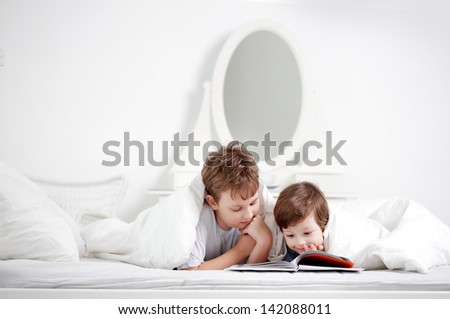happy boy read book - stock photo