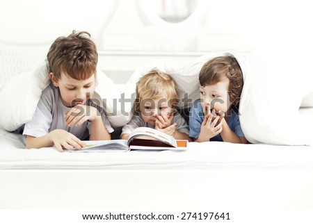 happy boy read book home