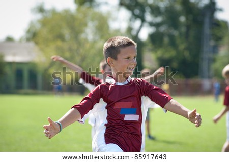 happy boy rejoices after victory - stock photo