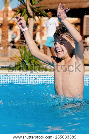 Happy boy, relaxing on a swimming pool at aqua park - stock photo