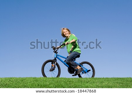 happy boy riding a bike