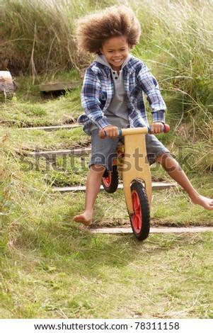 Happy boy riding a bike - stock photo