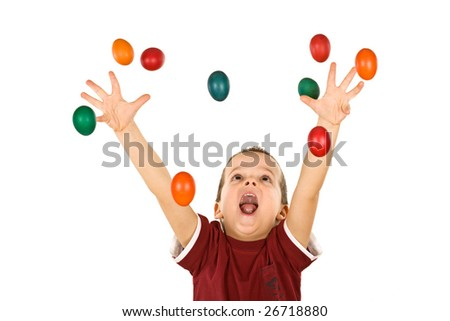 Happy boy shouting and reaching out for the falling colorful easter eggs - isolated, without motion blur - stock photo