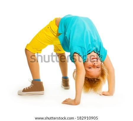 Happy boy showing acrobatic trick - stock photo