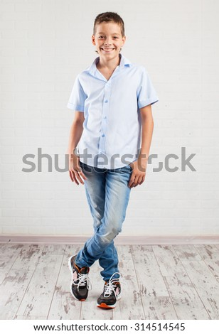 Happy boy. Smiling teenager at school - stock photo