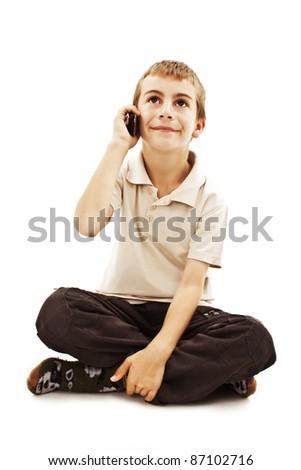 Happy boy speak on the phone looking up. Isolated on white background - stock photo
