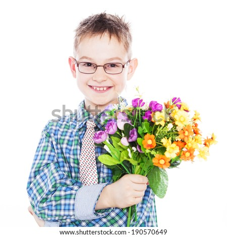 Happy boy standing with a bouquet of colourful flowers
