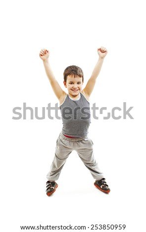 Happy boy standing with arms open. Isolated on white background - stock photo