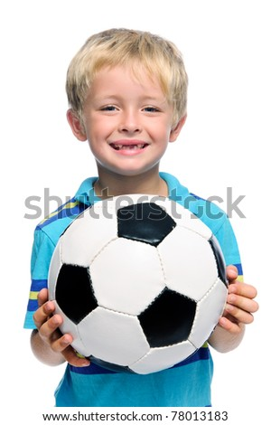 Happy boy stands with a football, aspiring to be a professional soccer player - stock photo
