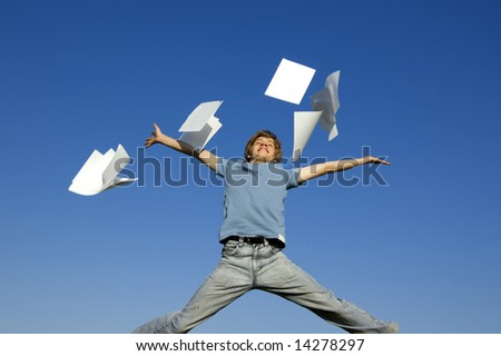 Happy boy throw up pieces of paper. The start of holiday - stock photo