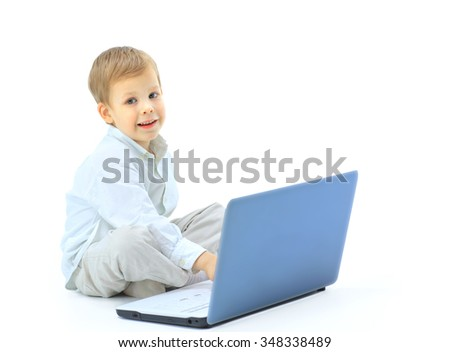 happy boy using the computer - stock photo