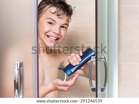 Happy boy washing head in shower in the bathroom - stock photo
