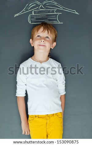 Happy boy with a book - stock photo