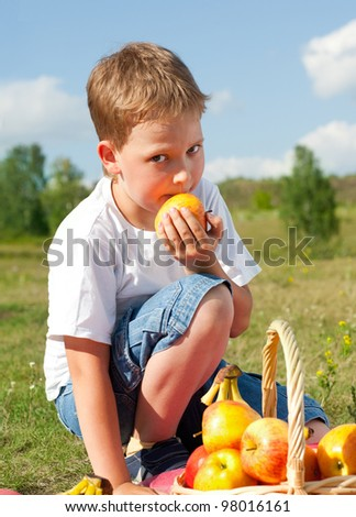 happy boy with apples resting outdoor